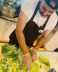 Employee Mo Prepping Salad