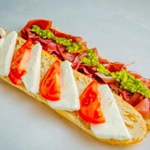 Lunch - Italian Sandwich with Prosciutto Mozzarella Cheese Pesto and Tomatoes